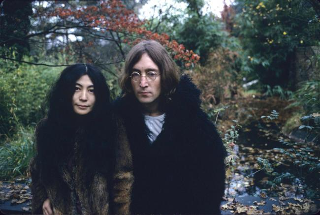 Yoko Ono and John Lennon (Photo by Susan Wood/Getty Images).