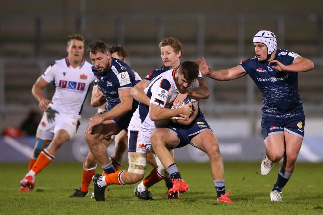 Luke Crosbie is tackled by Sale's Robert du Preez during Edinburgh's European Champions Cup win at the AJ Bell Stadium