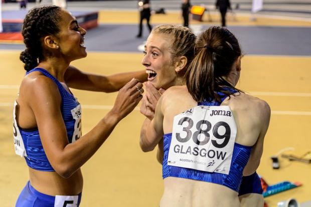 HeraldScotland: A delighted Jemma Reekie is hugged by Laura Muir after breaking the British indoor 800m record at Emirates Arena in Glasgow