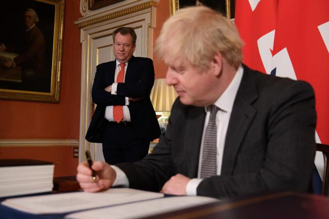 UK chief trade negotiator, David Frost looks on as Prime Minister Boris Johnson signs the EU-UK Trade and Cooperation Agreement at 10 Downing Street on Hogmanay