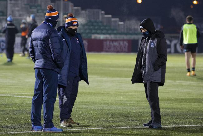 Glasgow head coach Danny Wilson, right, speaks to Edinburgh's Richard Cockerill before their game was called off on Friday