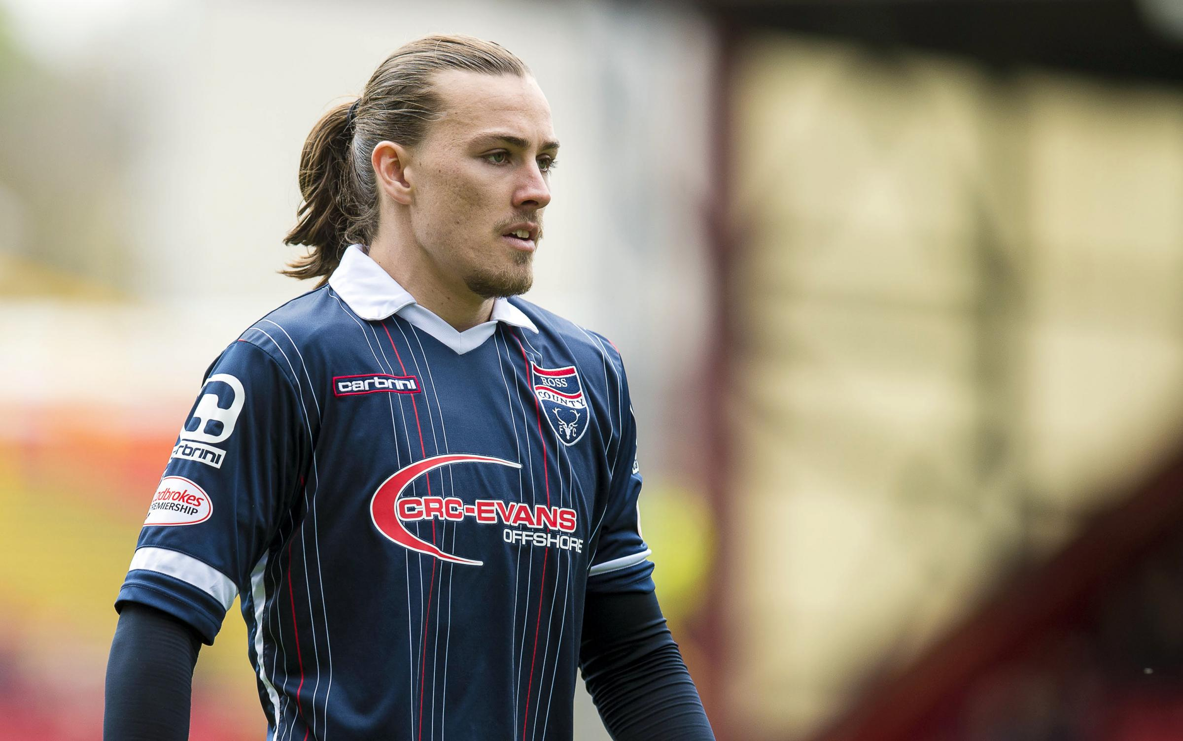 Hibs sign former Ross County midfielder Jackson Irvine following Hull City exit