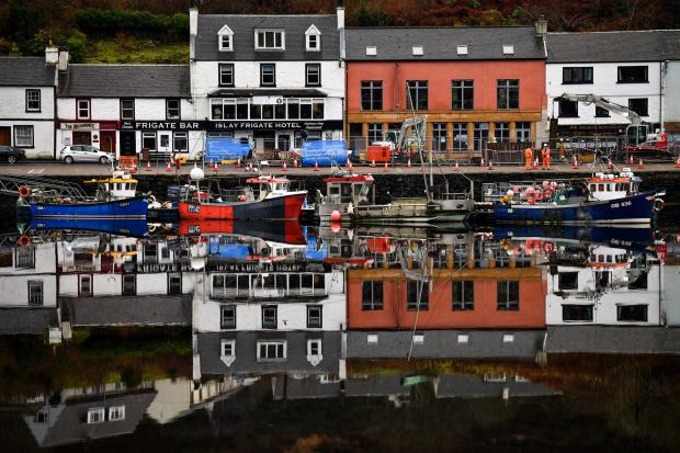 HeraldScotland: Fishing boats are tied up at Tarbert Harbour. Picture: Jeff J Mitchell/Getty Images).