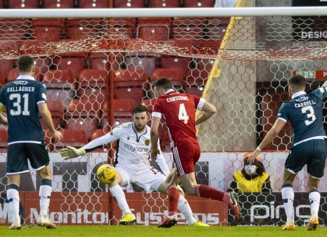 Pittodrie defender Andrew Considine makes it 2-0 to Aberdeen