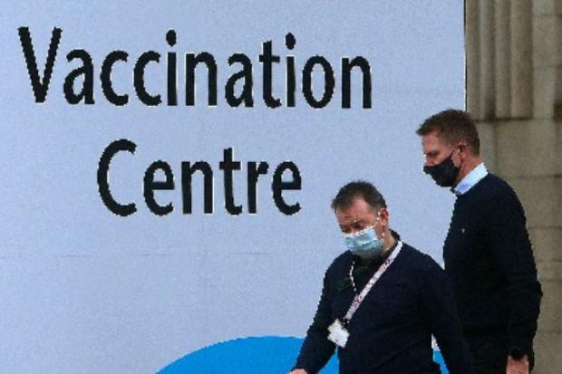 HeraldScotland: Volunteers and NHS staff prepare to open the mass vaccination centre yesterday at the Edinburgh International Conference Centre. Appointments will start on Monday.