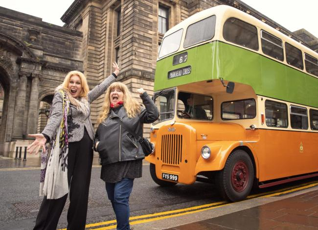 Joanna Lumley visits Glasgow and hops on a vintage Corporation Bus for a tour of the city with comedian Janey Godley. Picture: Burning Bright/ITV