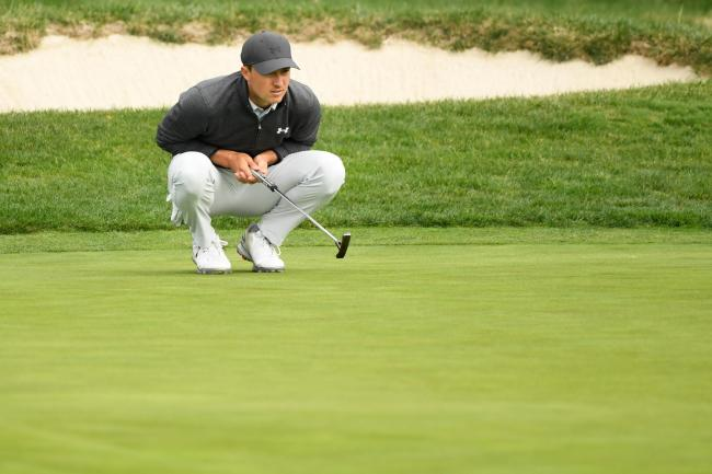 Jordan Spieth lines up a putt in California