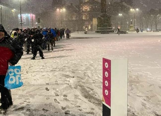 More than 200 people queued in the snow for Kindness Homeless Street Team's soup kitchen earlier this month