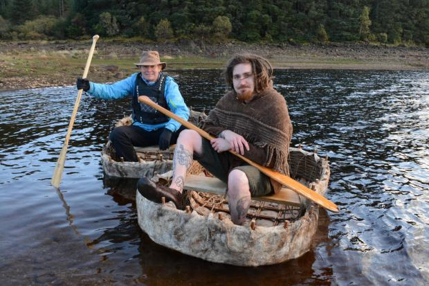 HeraldScotland: Paul Murton paddles a coracle on Loch Glashan. Picture: Tern TV/BBC