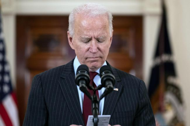 President Joe Biden reads the number of American that died from Covid-19 during a speech at the White House, Monday, Feb. 22, 2021, in Washington. (AP Photo/Evan Vucci).