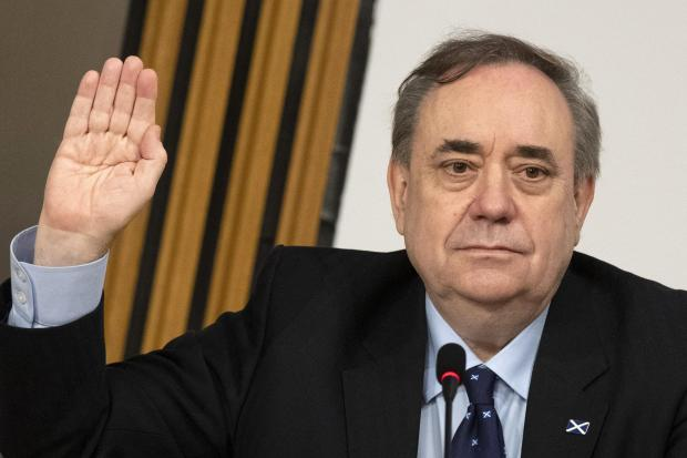 HeraldScotland: Former first minister Alex Salmond is sworn in before giving evidence to a Scottish Parliament Harassment committee, at Holyrood in Edinburgh, examining the handling of harassment allegations him. Picture date: Friday February 26, 2021. PA Photo. See PA s