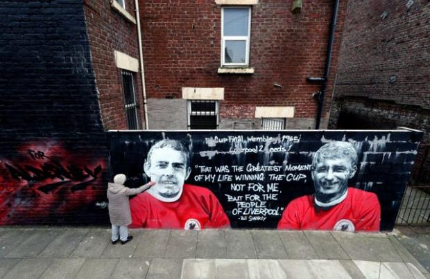 HeraldScotland: A mural in Liverpool alongside striker partner Roger Hunt (Peter Byrne/PA)
