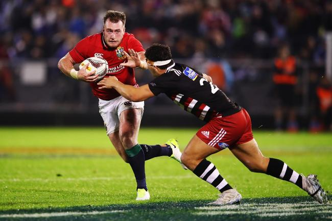Scotland's Stuart Hogg (left) rides a challenge while playing for the Lions
