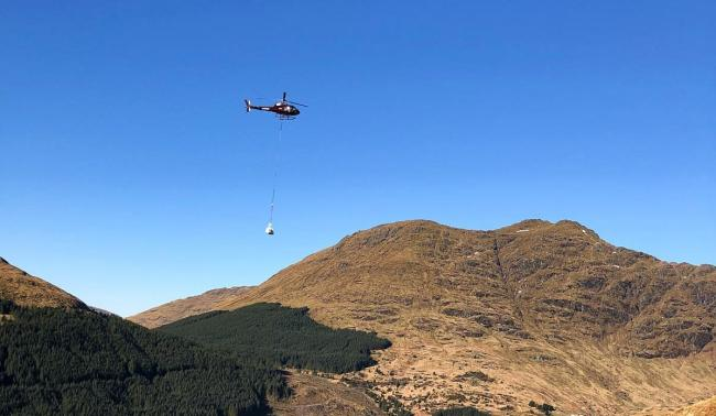 A helicopter was brought in to bring materials up the hillside to allow teams to stabilise boulders  Source: Bear Scotland