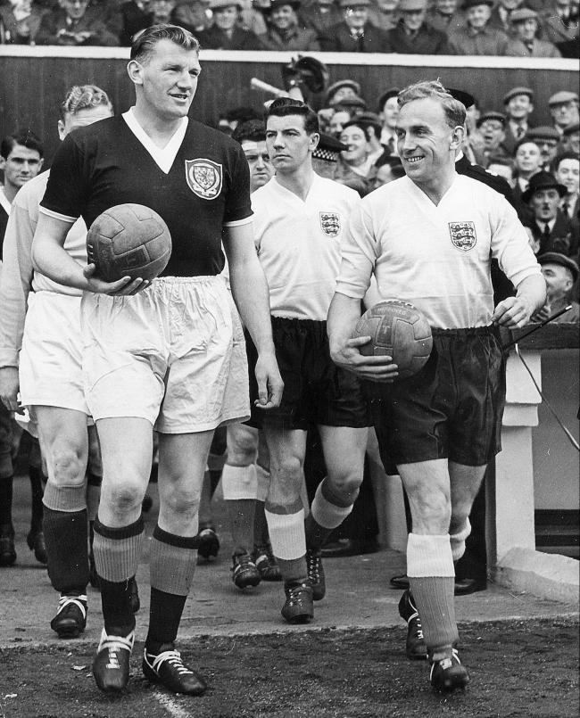 George Young and Billy Wright lead out the teams for the Scotland-England match in April 1956