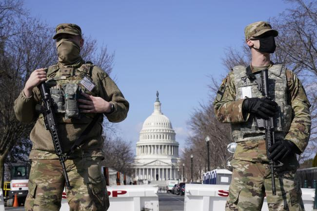 National Guard keep watch on the Capitol, Thursday, March 4, 2021, on Capitol Hill in Washington