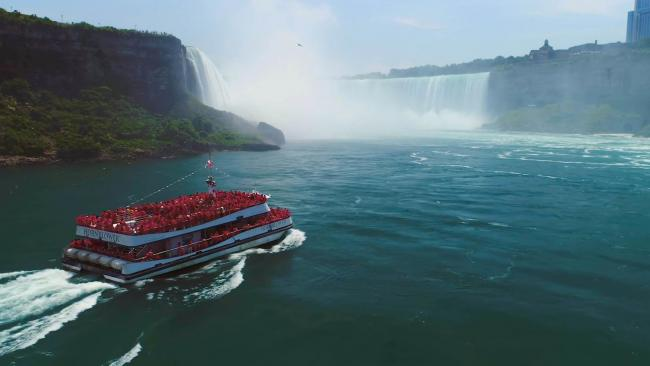 Thousands of tourists wearing waterproof ponchos take a boat trip to the base of Niagara Falls every year. Picture: Saloon Media/Britespark films/Channel 5