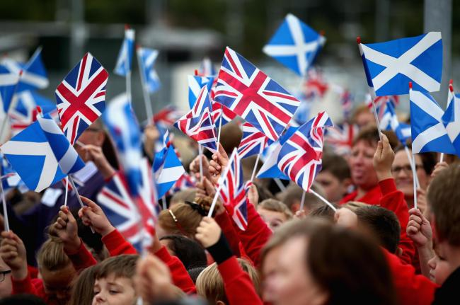 Scottish flags and Union flags are waved at the opening of the Borders Railway at Tweedbank Station on September 9, 2015 in Tweedbank, Scotland. Photo by Chris Jackson/Getty Images