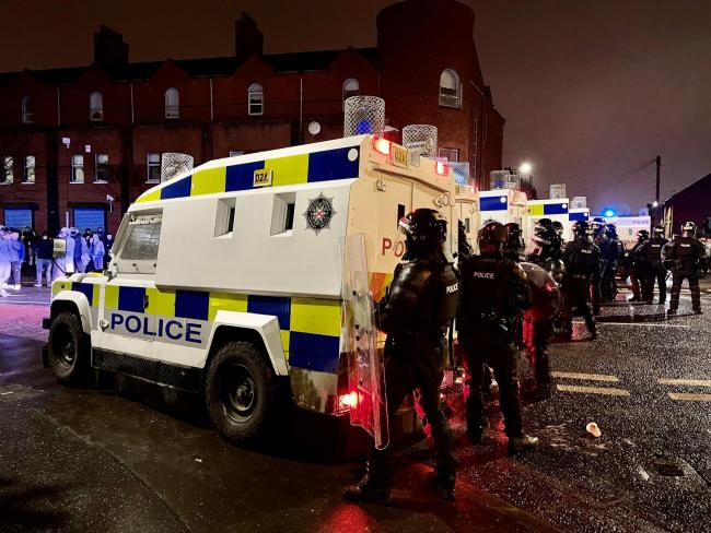 Police officers face up to unrest in Belfast earlier this week