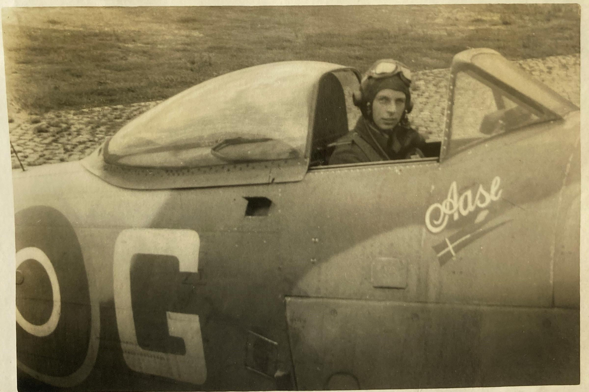 Fg Off. Forrest in Typhoon Ib SF-G. The aircraft has the girl name 'Aase' and the flag of the Kingdom of Denmark on the side of the fuselage. The photo was taken at B.160 Copenhagen/Kastrup or later, when the squadron had moved on to B.172 Husum on 21 June 1945.