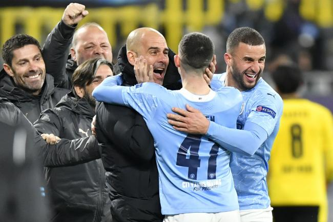 Manchester City manager Pep Guardiola celebrates with his players