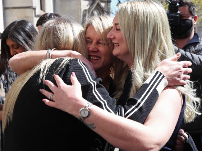 Former post office worker Janet Skinner (centre) celebrates with her niece Hayley Adams (right) and her daughter Toni Sisson after her conviction caused by the failed Horizon IT system was overturned by the Court of Appeal last week