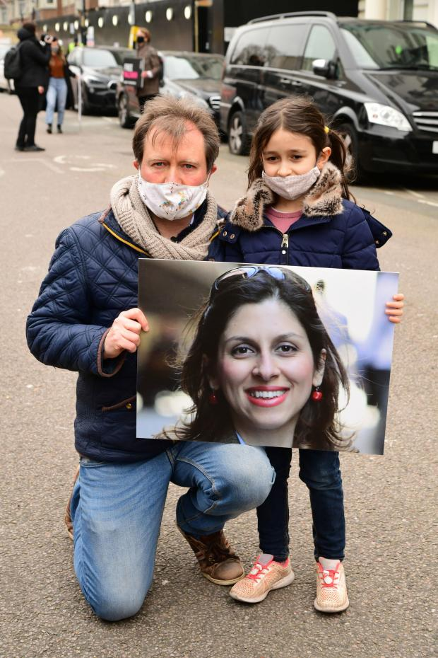 HeraldScotland: Richard Ratcliffe, the husband of Nazanin Zaghari-Ratcliffe, with his daughter Gabriella during a protest outside the Iranian Embassy in London. Photo: Ian West