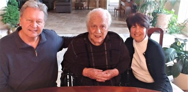 John Rattenbury, centre, pictured on his 91st birthday. Photo courtesy of the Taliesan Fellows, Scottsdale, Arizona