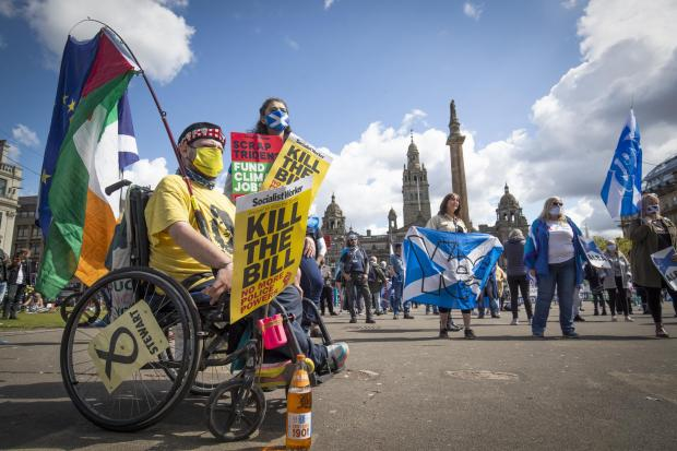 Protesters march during the Scottish Independence Day in Glasgow, Herald Scotland-George Square.  Picture Day: Saturday, May 1, 2021.