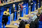 Election agents observe the count at the Emirates Arena, Glasgow.