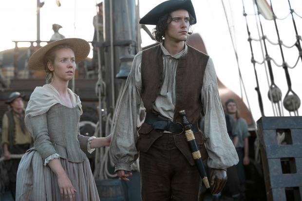 HeraldScotland: Lauren Lyle with her Outlander co-star Cesar Domboy. Picture: Starz