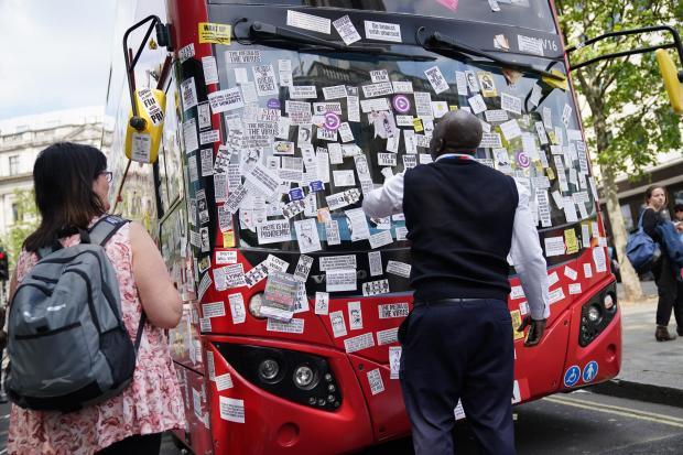 HeraldScotland: A London Bus is covered in anti-vaccine stickers near Trafalgar Square following a anti-vaccine protest in central London.