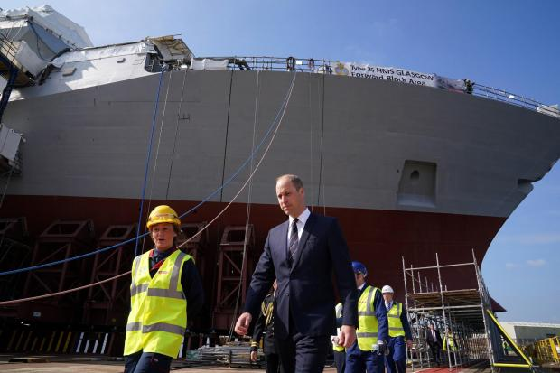 HeraldScotland: The Duke of Cambridge, known as the Earl of Strathearn in Scotland, alongside apprentice Cara Shannon as they view construction work on HMS Glasgow. Picture: Andrew Milligan.