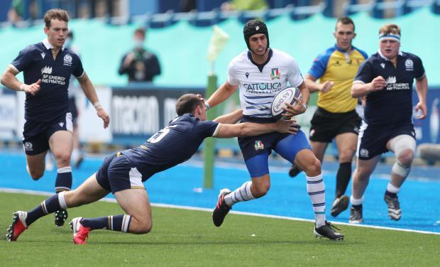 HeraldScotland: Italy's Simone Gesi is tackled by Scotland's Elliot Gourlay