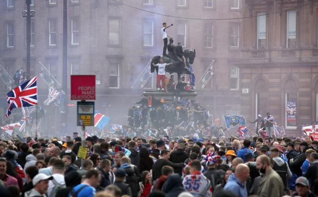 Four more arrests linked to Rangers fans disorder in George Square