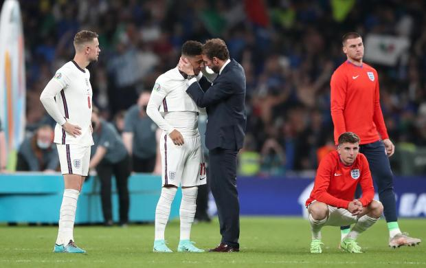 HeraldScotland: Southgate comforts Sancho after penalty miss