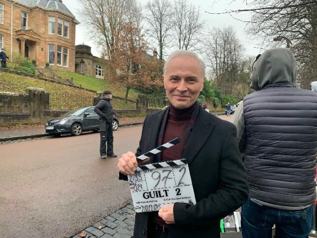 HeraldScotland: Mark Bonnar filming series two of Guilt. Picture: BBC
