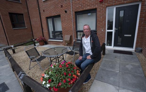 HeraldScotland: Ian Alexander in the garden of his new flat