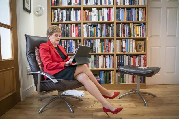 HeraldScotland: Nicola Sturgeon at her home preparing her speech she will give to the SNP National Conference virtually