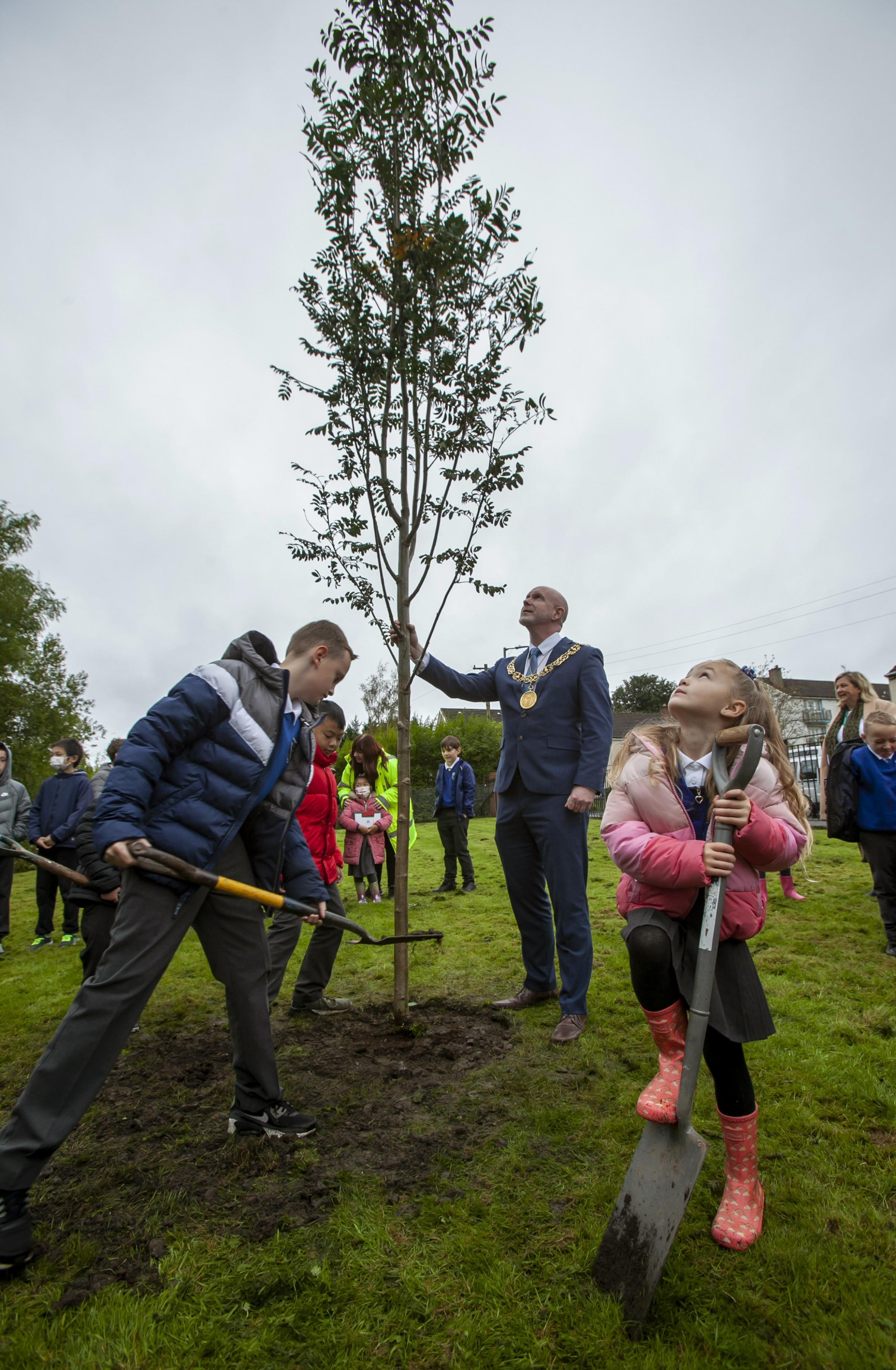 Glasgow Lord Provost Philip Braat in his as Lord Lieutenant, representing the Queen, pictured planting a tree at Cadder Primary school. He is pictured with members of the schools eco committee, from left Jason Lam, Orlagh Gallagher, Junior Mactavish