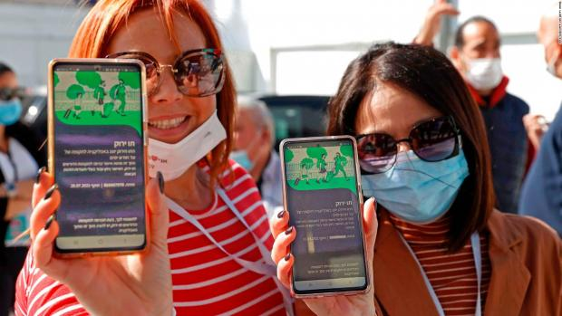 HeraldScotland: Israelis with the country's 'green pass' app which is required for entry into a wide range of public spaces, including bars and restaurants