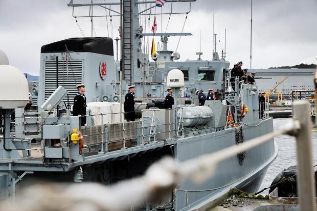 HeraldScotland: Crew members on the deck of HMS Shoreham as she comes alongside in the Naval Base.