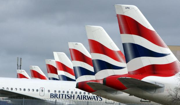 HeraldScotland: British Airways planes parked at the firm's engineering base at Heathrow Airport. The airport's new Terminal 2 will welcome 20 millions passengers a year