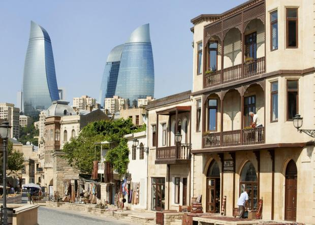 HeraldScotland: A view of the Flame Towers from the Old Town of Baku. The towers rise nearly 800ft and have foundations equally as deep