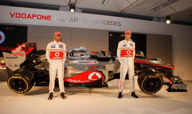 Lewis Hamilton and Jenson Button at the unveiling of McLaren's MP-27 F1 car for 2012