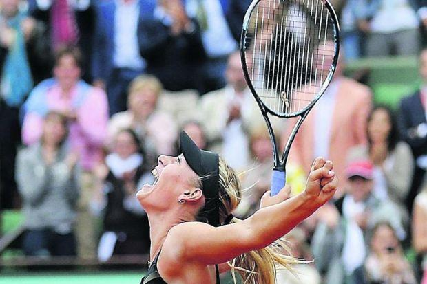 Maria Sharapova shrieks with delight following victory in Paris                           Photograph: AP