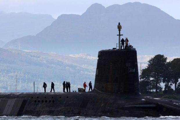 port SIDE: A Trident submarine makes its way out to sea from Faslane naval base, home of the UK's nuclear deterrent. Picture: Getty Images