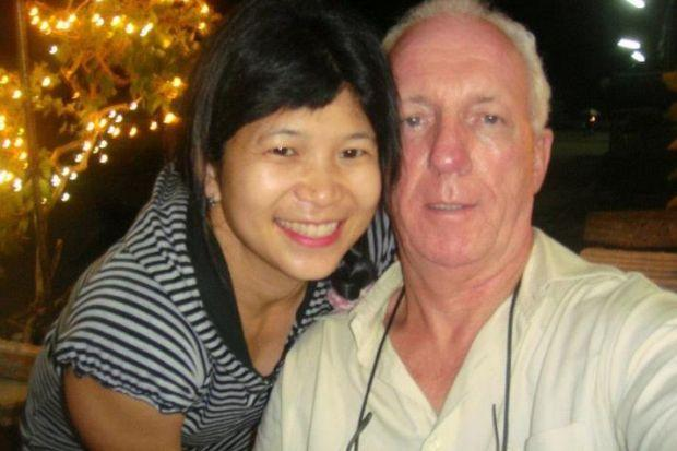 DEPORTED: John Joseph Alty with a member of staff at The Squealing Pig, a guest house he ran in Thailand, has returned to the UK.