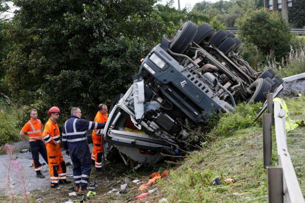 LUCKY ESCAPE: A lorry driver was taken to hospital after his vehicle overturned on the A726 near Glasgow Airport and came to rest on a 20ft embankment.