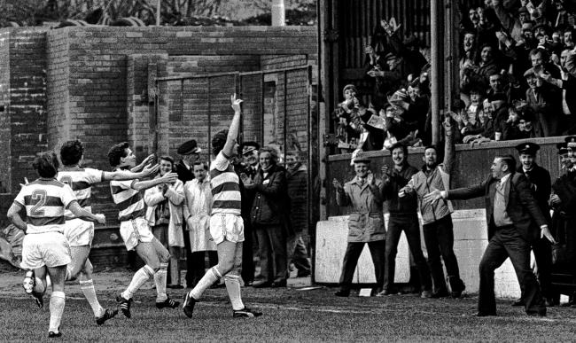 Andy Ritchie takes the acclaim of the Morton fans after scoring against Aberdeen in a match at Cappielow in 1981. Picture: SNS